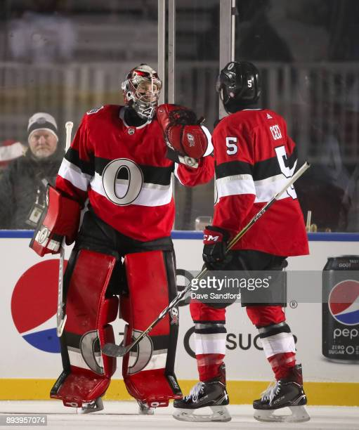 Craig Anderson and Cody Ceci of the Ottawa Senators celebrate after a 30 win over the Montreal Canadiens during the 2017 Scotiabank NHL100 Classic at...