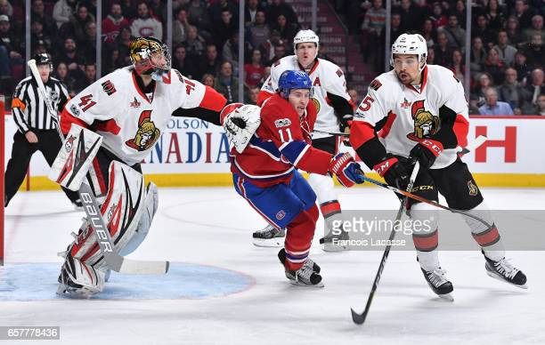 Craig Anderson and Cody Ceci of the Ottawa Senators protect the net against Brendan Gallagher of the Montreal Canadiens in the NHL game at the Bell...