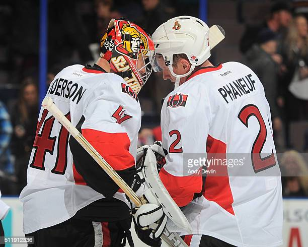 Craig Anderson and Dion Phaneuf of the Ottawa Senators celebrate after winning the game against the Edmonton Oilers on February 23 2016 at Rexall...