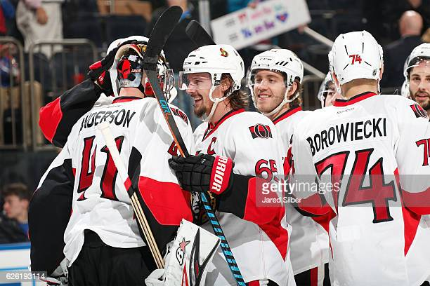 Craig Anderson and Erik Karlsson of the Ottawa Senators celebrate after defeating the New York Rangers 20 at Madison Square Garden on November 27...