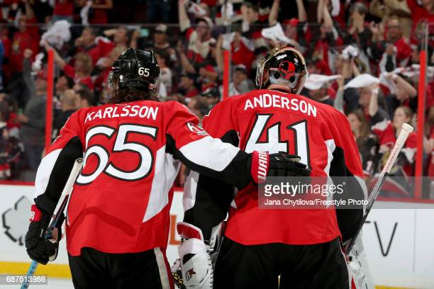 Craig Anderson and Erik Karlsson of the Ottawa Senators celebrate after defeating the Pittsburgh Penguins with a score of 2 to 1 in Game Six of the...