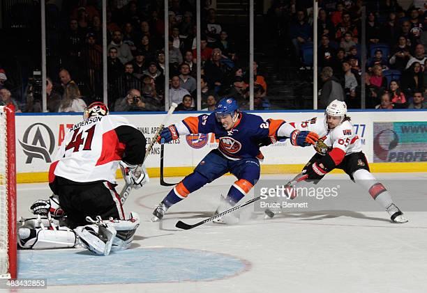 Craig Anderson and Erik Karlsson of the Ottawa Senators combine to stop Anders Lee of the New York Islanders at the Nassau Veterans Memorial Coliseum...