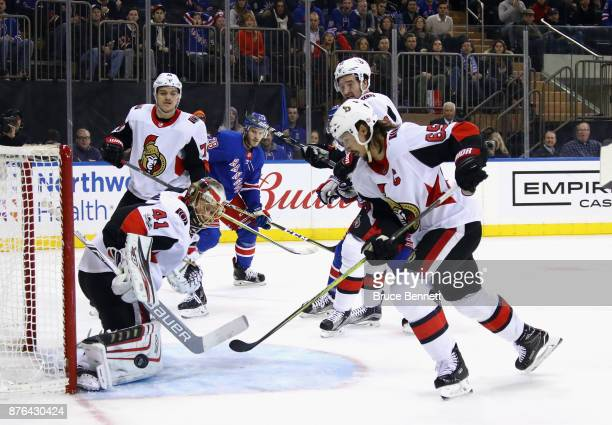 Craig Anderson and Erik Karlsson of the Ottawa Senators defend the net during the second period against the New York Rangers at Madison Square Garden...