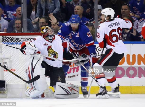 Craig Anderson of the Ottawa Senators and Mike Hoffman defend against Rick Nash of the New York Rangers during the third period in Game Three of the...
