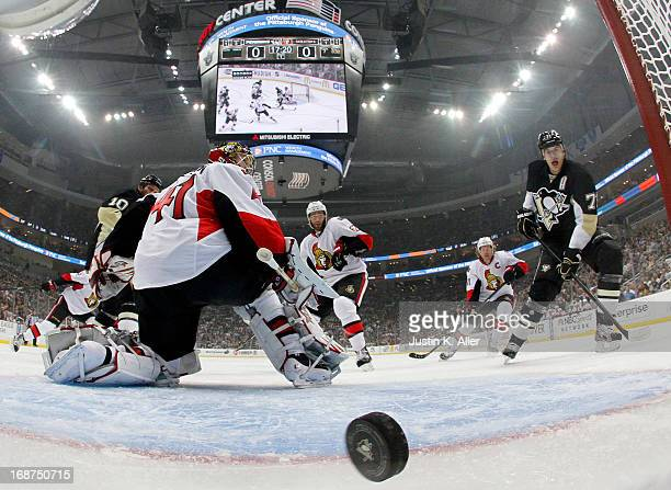 Craig Anderson of the Ottawa Senators can't stop a goal by Paul Martin of the Pittsburgh Penguins in Game One of the Eastern Conference Semifinals...