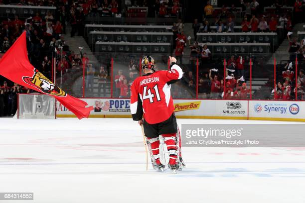 Craig Anderson of the Ottawa Senators celebrates after defeating the Pittsburgh Penguins with a score of 5 to 1 in Game Three of the Eastern...