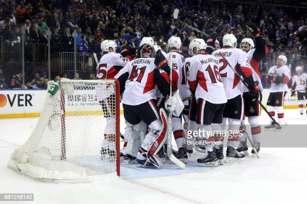Craig Anderson of the Ottawa Senators celebrates with his teammates after defeating the New York Rangers in Game Six of the Eastern Conference Second...