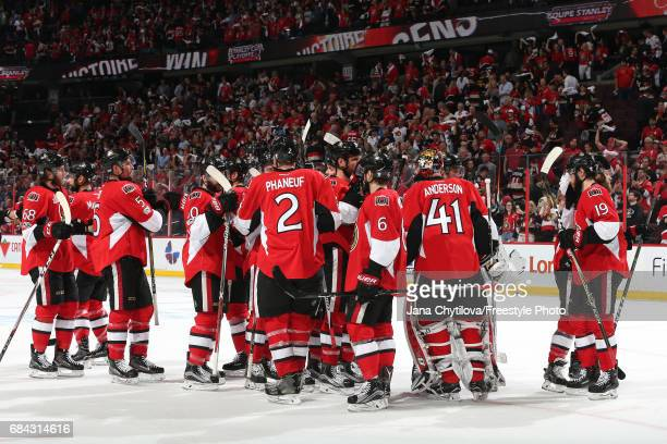 Craig Anderson of the Ottawa Senators celebrates with his teammates after defeating the Pittsburgh Penguins with a score of 5 to 1 in Game Three of...