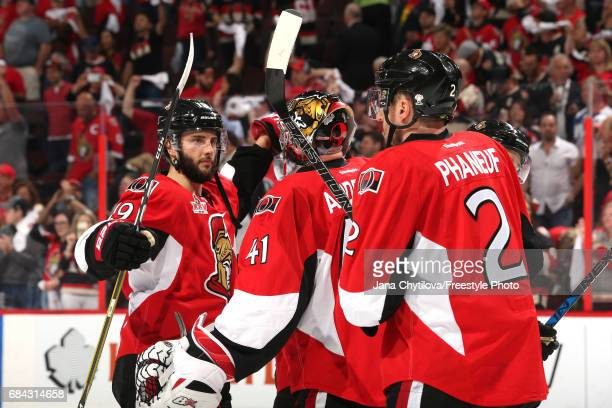 Craig Anderson of the Ottawa Senators celebrates with his teammates Derick Brassard and Dion Phaneuf after defeating the Pittsburgh Penguins with a...