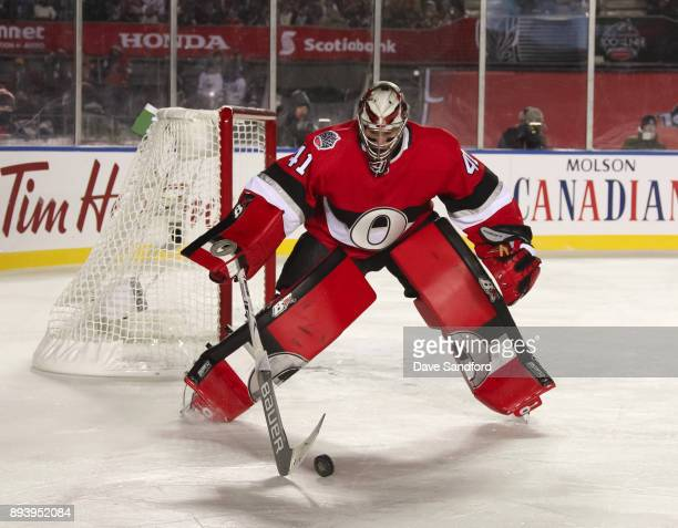 Craig Anderson of the Ottawa Senators controls a bouncing puck in a game against the Montreal Canadiens during the 2017 Scotiabank NHL100 Classic at...