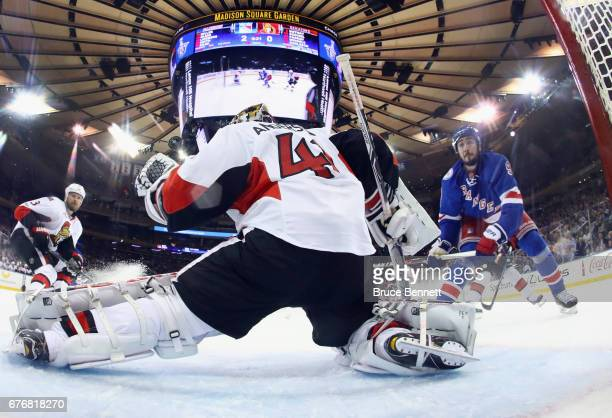 Craig Anderson of the Ottawa Senators defends against Mika Zibanejad of the New York Rangers in Game Three of the Eastern Conference Second Round...