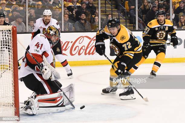 Craig Anderson of the Ottawa Senators deflects the puck against Frank Vatrano of the Boston Bruins at the TD Garden on April 6 2017 in Boston...
