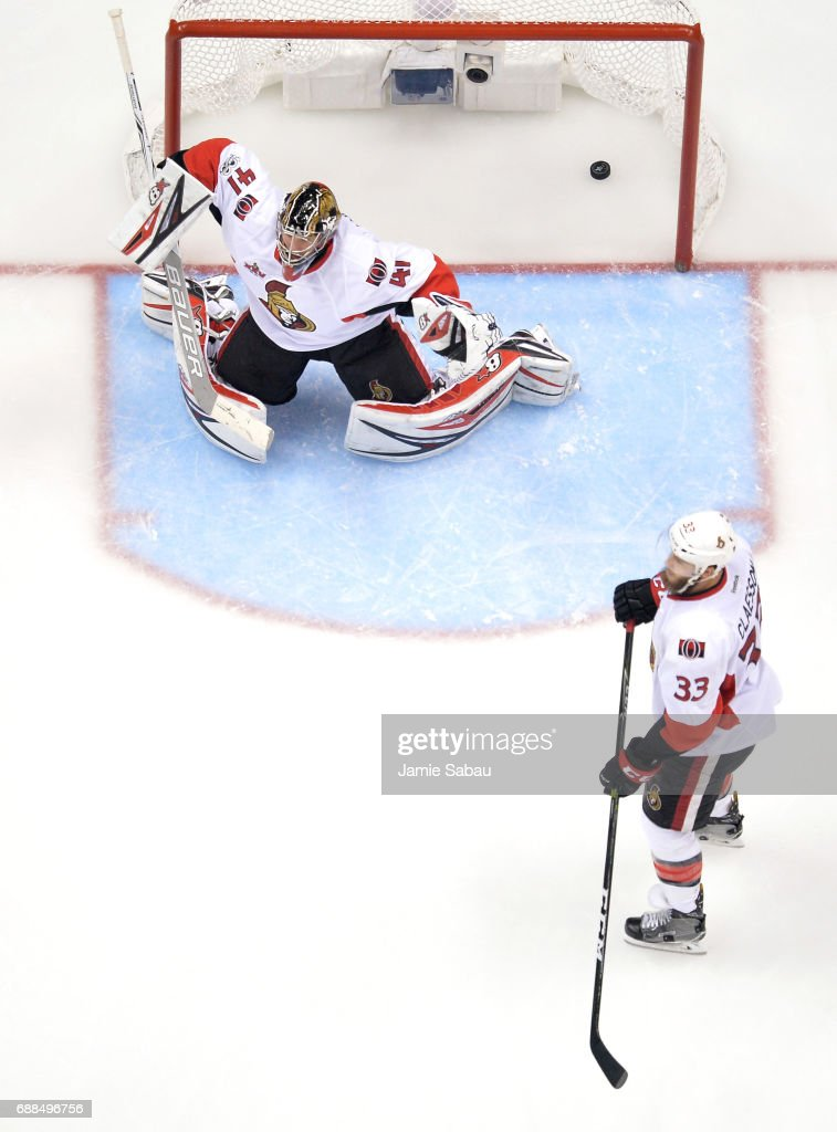 Craig Anderson #41 of the Ottawa Senators gives up the game winning goal to Chris Kunitz #14 of the Pittsburgh Penguins in the second oevertime in Game Seven to win the Eastern Conference Final during the 2017 NHL Stanley Cup Playoffs at PPG PAINTS Arena on May 25, 2017 in Pittsburgh, Pennsylvania. The Pittsburgh Penguins defeated the Ottawa Senators with a score of 3 to 2.