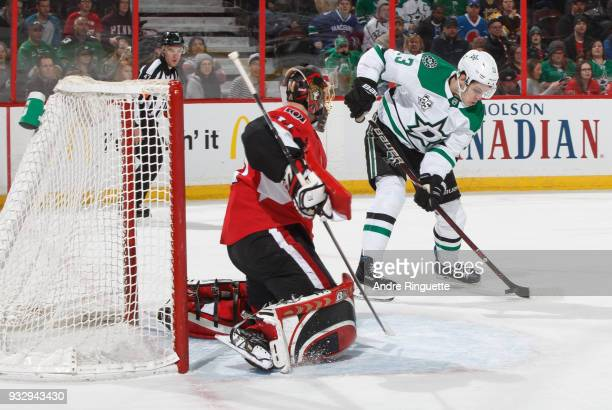 Craig Anderson of the Ottawa Senators guards his net against a scoring chance by Esa Lindell of the Dallas Stars in overtime at Canadian Tire Centre...