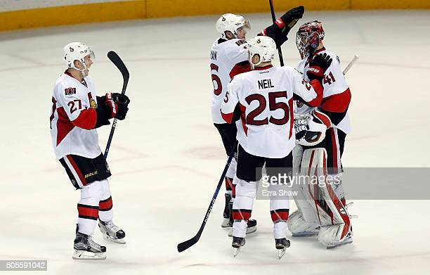 Craig Anderson of the Ottawa Senators is congratualted by Bobby Ryan Chris Neil and Curtis Lazar after they beat the San Jose Sharks at SAP Center on...