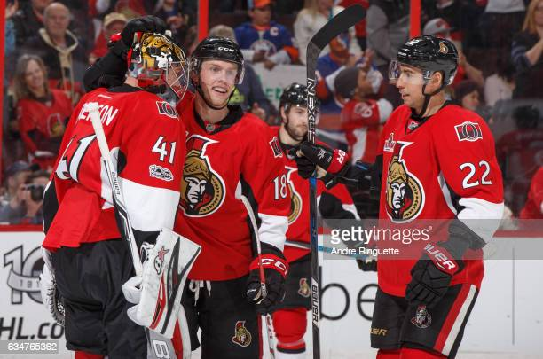 Craig Anderson of the Ottawa Senators is congratulated by teammates Ryan Dzingel and Chris Kelly for his 30 shutout win over the New York Islanders...