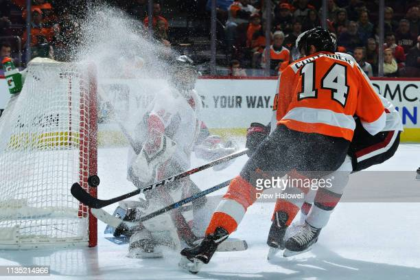 Craig Anderson of the Ottawa Senators looks back at the puck as it hits off of the goal post on a shot by Sean Couturier of the Philadelphia Flyers...