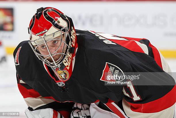 Craig Anderson of the Ottawa Senators looks on during warmup prior to a game against the Carolina Hurricanes at Canadian Tire Centre on February 18...