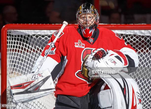 Craig Anderson of the Ottawa Senators looks on from his crease during player introductions prior to playing against the New York Rangers in Game One...