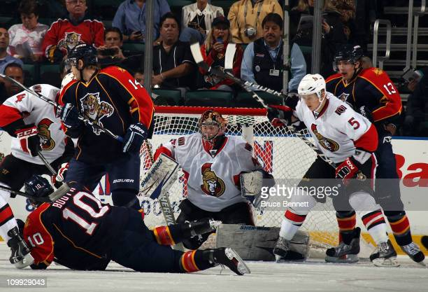Craig Anderson of the Ottawa Senators looks to stop the puck in a crowd in his game against the Florida Panthers at the BankAtlantic Center on March...