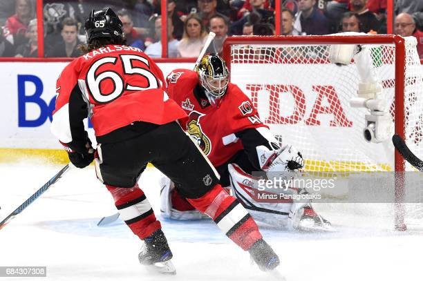 Craig Anderson of the Ottawa Senators makes a glove save against the Pittsburgh Penguins during the second period in Game Three of the Eastern...