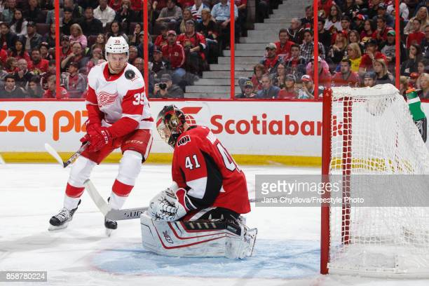 Craig Anderson of the Ottawa Senators makes a save against Anthony Mantha of the Detroit Red Wings at Canadian Tire Centre on October 7 2017 in...