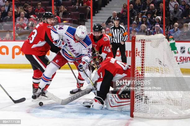 Craig Anderson of the Ottawa Senators makes a save against Boo Nieves of the New York Rangers as Nick Paul and Tom Pyatt of the Ottawa Senators...
