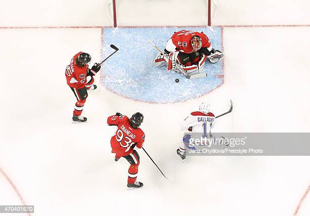 Craig Anderson of the Ottawa Senators makes a save against Brendan Gallagher of the Montreal Canadiens as Erik Karlsson and Mika Zibanejad of the...