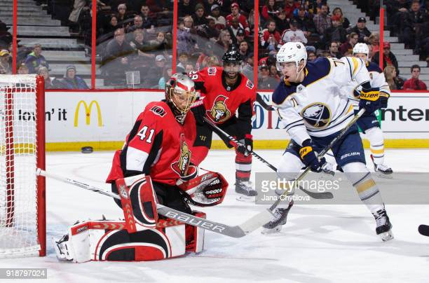 Craig Anderson of the Ottawa Senators makes a save against Evan Rodrigues of the Buffalo Sabres as Johnny Oduya of the Ottawa Senators looks on in...