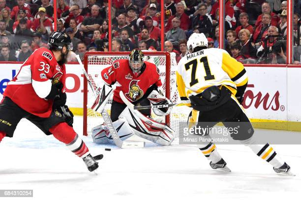 Craig Anderson of the Ottawa Senators makes a save against Evgeni Malkin of the Pittsburgh Penguins during the second period in Game Three of the...