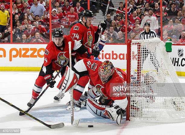 Craig Anderson of the Ottawa Senators makes a save against the Montreal Canadiens as team mates JeanGabriel Pageau and Mark Borowiecki defend the net...