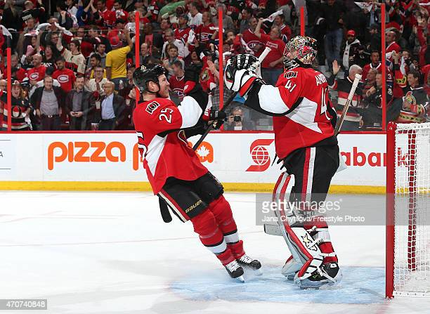 Craig Anderson of the Ottawa Senators celebrates their win against the Montreal Canadiens with team mate Chris Neil in Game Four of the Eastern...