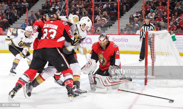 Craig Anderson of the Ottawa Senators makes a save against Tomas Nosek of the Vegas Golden Knights as Fredrik Claesson of the Ottawa Senators defends...