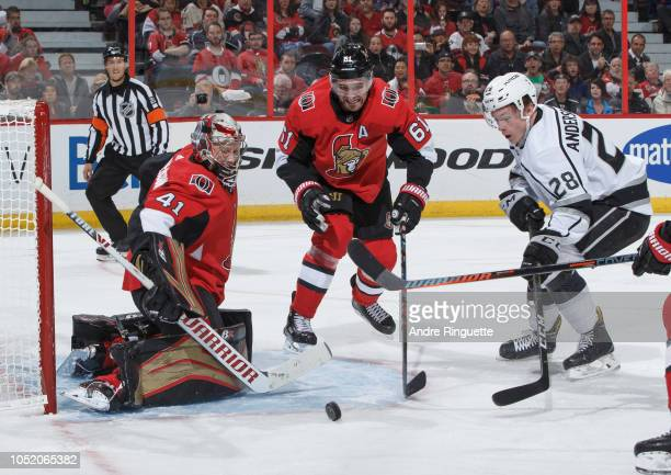 Craig Anderson of the Ottawa Senators makes a save as teammate Mark Stone battles Jaret AndersonDolan of the Los Angeles Kings for the rebound at...