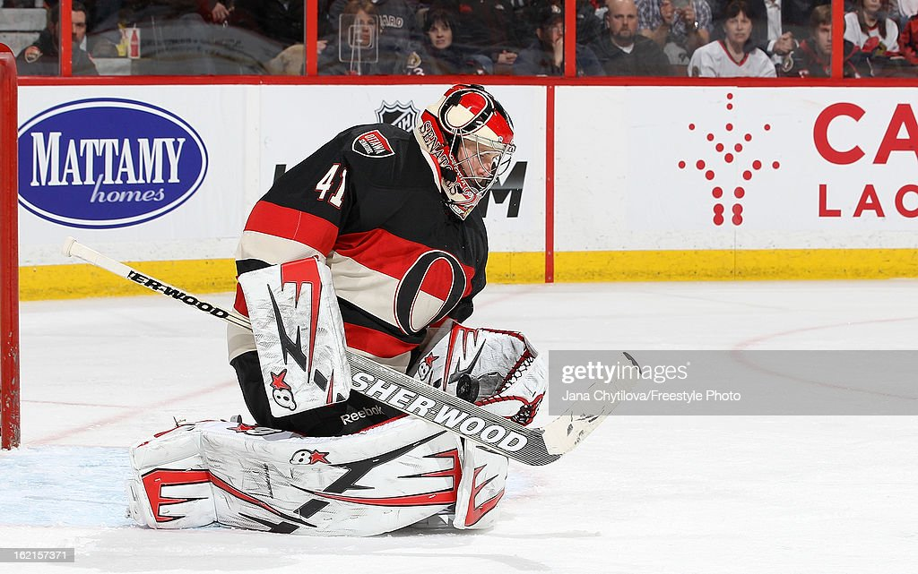 Craig Anderson #41 of the Ottawa Senators makes one of his thirty-seven saves during an NHL game against the New York Islanders, at Scotiabank Place on February 19, 2013 in Ottawa, Ontario, Canada.