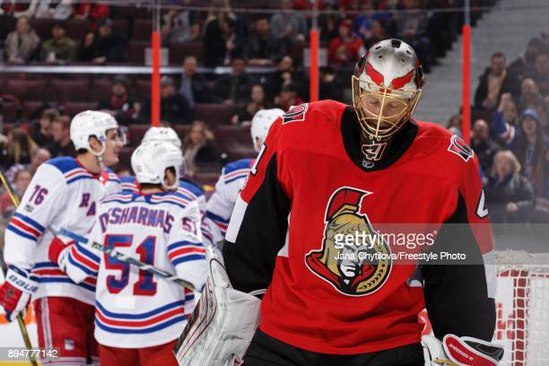 Craig Anderson of the Ottawa Senators reacts after allowing a third period goal by Pavel Buchnevich as David Desharnais and Brady Skjei of the New...
