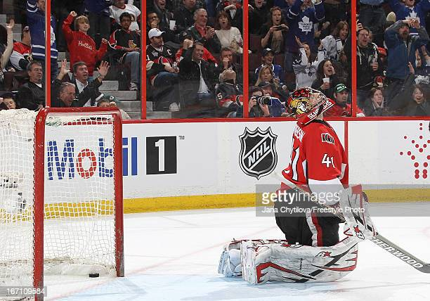 Craig Anderson of the Ottawa Senators reacts after allowing the third goal of the game during an NHL game against the Toronto Maple Leafs at...