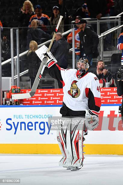 Craig Anderson of the Ottawa Senators salutes the crowed after being selected as the first star of the game following the game against the Edmonton...