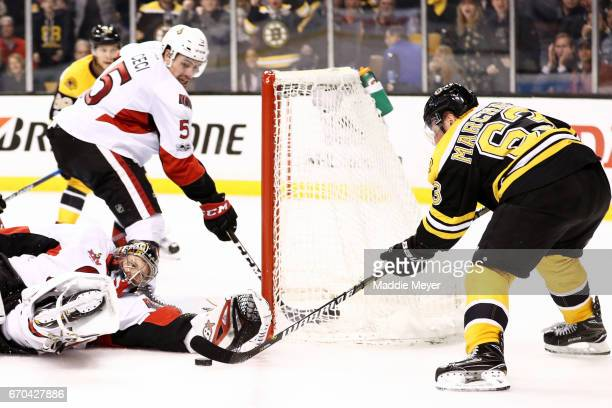 Craig Anderson of the Ottawa Senators saves a shot from Brad Marchand of the Boston Bruins during the third period of Game Four of the Eastern...