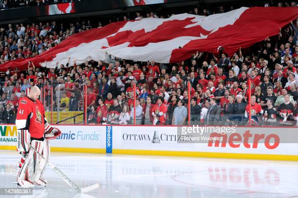 Craig Anderson of the Ottawa Senators stands during the singing of the Canadian national anthem prior to facing the New York Rangers in Game Three of...