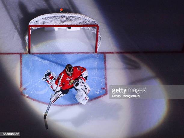 Craig Anderson of the Ottawa Senators stretches during the pre game ceremony against the Pittsburgh Penguins in Game Four of the Eastern Conference...