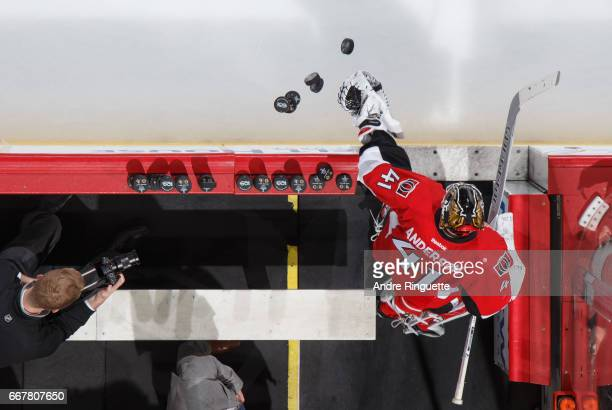Craig Anderson of the Ottawa Senators swipes at a stack of puck to start warmup prior to playing against the Boston Bruins in Game One of the Eastern...