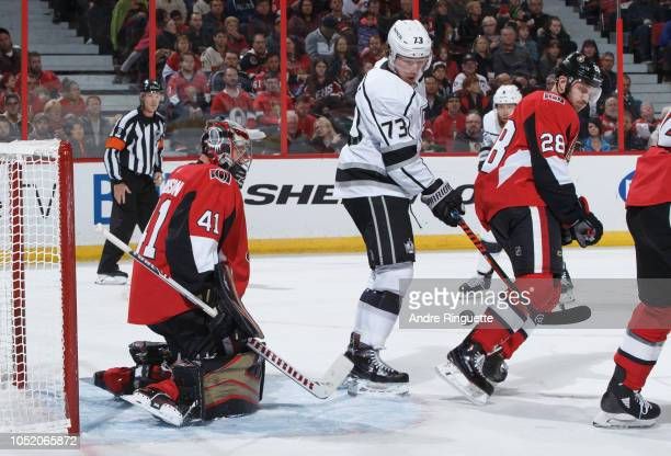 Craig Anderson of the Ottawa Senators tends net as Tyler Toffoli of the Los Angeles Kings tips the puck behind Paul Carey at Canadian Tire Centre on...