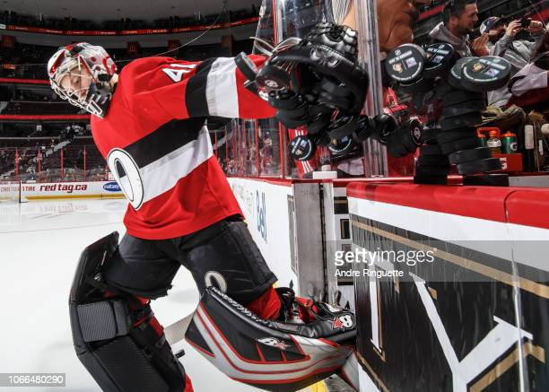 Craig Anderson of the Ottawa Senators tips over a stack of pucks before warm up prior to a game against the New York Rangers at Canadian Tire Centre...
