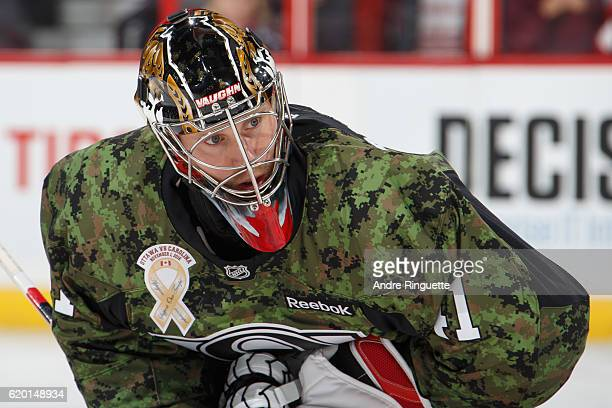 Craig Anderson of the Ottawa Senators warms up wearing a camouflage jersey on Canadian Forces Appreciation Night prior to a game against the Carolina...