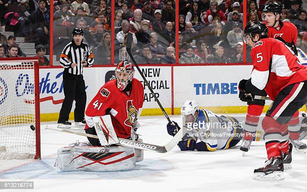 Craig Anderson of the Ottawa Senators watches the puck go past him for a powerplay goal as team mates Cody Ceci and Dion Phaneuf look on and as David...