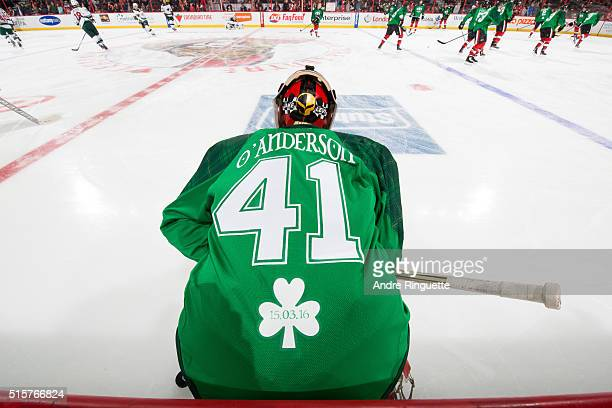 Craig Anderson of the Ottawa Senators wears a green St Patrick's Day warm up jersey during warmup prior to an NHL game against the Minnesota Wild at...