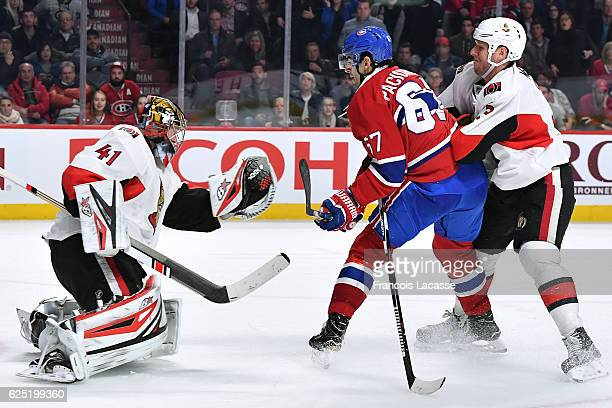 Craig Anderson the Ottawa Senators makes a glove save in front of Max Pacioretty of the Montreal Canadiens in the NHL game at the Bell Centre on...