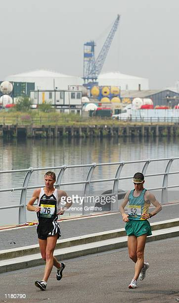 Craig Barrett of New Zealand and Nathan Deakes of Australia lead the Men's 50 kilometers walk in Salford Quays in Manchester England on JULY 30 2002
