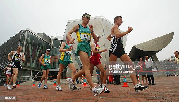 Craig Barrett of New Zealand and Nathan Deakes of Australia lead the field in front of the Lowrey Centre during the Mens 50 kilometers walk in...